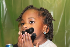 Nia putting on her mustache